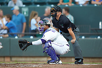 Winston-Salem Dash catcher Yermin Mercedes (6) sets a target as home plate umpire Isaias Barba looks on during the game against the Frederick Keys at BB&T Ballpark on July 26, 2018 in Winston-Salem, North Carolina. The Keys defeated the Dash 6-1. (Brian Westerholt/Four Seam Images)