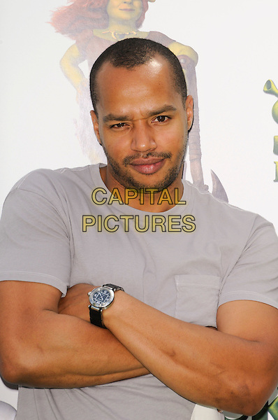 "DONALD FAISON .arriving at the Los Angeles premiere of Dreamworks Animation's ""Shrek Forever After"" at Gibson Amphitheatre in Universal City, California, .May 16th, 2010.half length grey gray t-shirt arms crossed folded wrist watch .CAP/ROT.©Lee Roth/Capital Pictures"