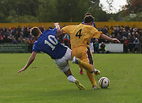 Lewis McLeod of Rangers gets a foot to the ball before Graeme Grant in the Forres Mechanics v Rangers William Hill Scottish Cup 2nd Round match, at Mosset Park, Forres on 29.9.12.