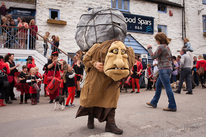 On the day of the giant bolster reenactment a local drum troop march from St Agnes railway station to the Driftwood inn, at Trevaunance Cove. The procession follws larger than life puppets depicting the search of Mayor Smason Sprocket and Knight Sir Constantine for the giant child-eating Bolster. St Agnes Bolster Festival 2014. ©Scott Garfitt 2014.