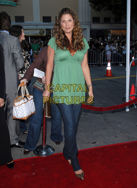 "DAISY FUENTES.At The Universal Pictures' World Premiere of .""The Break Up"" held at The Mann's Village Theatre, Westwood, California, USA, May 22, 2006..full length green top skinny jeans.Ref: DVS .www.capitalpictures.com.sales@capitalpictures.com.©Debbie VanStory/Capital Pictures"