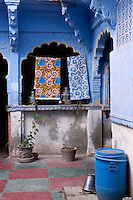 The blue-washed walls of this haveli enclose an inner courtyard with a painted stone flagged floor