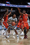 Brandon Childress (0) of the Wake Forest Demon Deacons is guarded by Justin Bibbs (10) and Ahmed Hill (13) of the Virginia Tech Hokies during first half action at the LJVM Coliseum on January 10, 2018 in Winston-Salem, North Carolina.  The Hokies defeated the Demon Deacons 83-75.  (Brian Westerholt/Sports On Film)