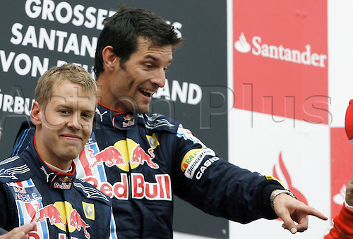 Australian Formula One driver Mark Webber of Red Bull Racing (r, 1st) and his teammate German Sebastian Vettel (2nd) celebrate on the podium after the Grand Prix of Germany at the Nuerburgring in Nuerburg, Germany, 12 July 2009. Photo: ROLAND WEIHRAUCH/ActionPlus UK Licenses Only