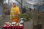 Shahnaz Begum, a mother of four, outside her home with her microloan-financed cows and her typical day's worth of food outside her home in the village of Bari Majlish, an hour outside Dhaka. (From the book What I Eat: Around the World in 80 Diets.) MODEL RELEASED