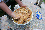 Mixing Peanut Butter & Oats For Traps