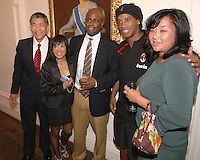 Will Chang of DC United and family pose with Ronaldinho of AC Milan at a reception for AC Milan at DAR Constitution Hall in Washington DC on May 24 2010.
