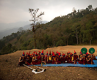 Buddhist monks performing rituals during the Losar New Year ceremony on a hilltop outside a monastery in Sikkim, India