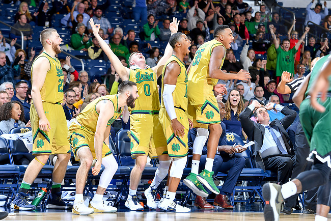 November 16, 2017; The starting 5 erupt in cheers after a three point basket by Matt Gregory (not shown) a 3-year walk-on who earned a scholarship for his final year on the team. (Photo by Matt Cashore/University of Notre Dame)