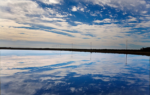 A pond reflects the bright sky in Baja California, Mexico
