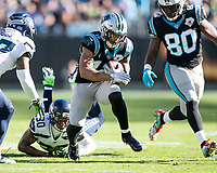 CHARLOTTE, NC - DECEMBER 15: D.J. Moore #12 of the Carolina Panthers runs with the ball during a game between Seattle Seahawks and Carolina Panthers at Bank of America Stadium on December 15, 2019 in Charlotte, North Carolina.