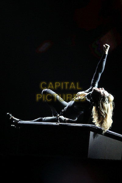 Madonna in concert, Moscow, Russia..August 7th, 2012.on stage live gig performance music full length black top leggings arm in air laying lying on floor ground .CAP/PER/AS.©AM/PersonaStars/CapitalPictures