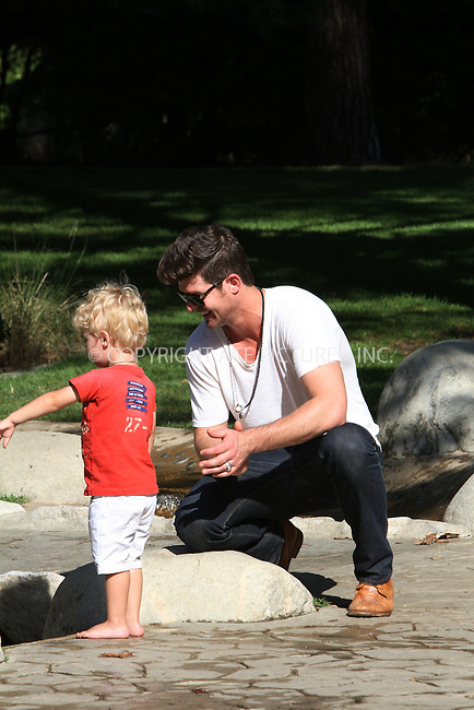 WWW.ACEPIXS.COM . . . . .  ....August 9 2012, LA....Musician Robin Thicke enjoys an afternoon in the park with his son Julian on August 9 2012 in Los Angeles....Plrease byline Zelig Shaul/ACE Pictures.... *** ***..Ace Pictures, Inc:  ..Philip Vaughan (212) 243-8787 or (646) 769 0430..e-mail: info@acepixs.com..web: http://www.acepixs.com
