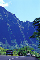 Vehicles driving over H3 freeway past Koolau Mountains from Kaneohe to Pearl Harbor