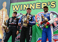 Apr 27, 2014; Baytown, TX, USA; NHRA top fuel dragster drivers (R-L) Antron Brown celebrates with funny car winner Robert Hight and pro stock winner Erica Enders-Stevens after winning the Spring Nationals at Royal Purple Raceway. Mandatory Credit: Mark J. Rebilas-