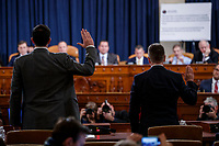 Former US Special Representative for Ukraine Kurt Volker (R) and former Senior Director for Europe and Russia at the National Security Council, Tim Morrison (L) are sworn in during the House Permanent Select Committee on Intelligence public hearing on the impeachment inquiry into US President Donald J. Trump, on Capitol Hill in Washington, DC, USA, 19 November 2019. The impeachment inquiry is being led by three congressional committees and was launched following a whistleblower's complaint that alleges US President Donald J. Trump requested help from the President of Ukraine to investigate a political rival, Joe Biden and his son Hunter Biden.<br /> Credit: Shawn Thew / Pool via CNP/AdMedia