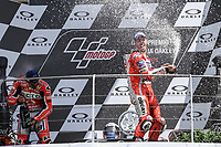 Ducati's Team rider Italian Andrea Dovizioso, winner  the Moto GP Grand Prix at the Mugello race track on June 4, 2017 celebrates on the podium. MotoGP Italy Grand Prix 2017 at Autodromo del Mugello, Florence, Italy on 4th June 2017. <br /> Photo by Danilo D'Auria.<br /> <br /> Danilo D'Auria/UK Sports Pics Ltd/Alterphotos /NortePhoto.com
