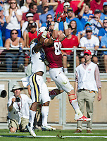 STANFORD, CA - October 19, 2013:  Stanford tight end Devon Cajuste (89) goes up for a catch during the Stanford Cardinal vs the UCLA Bruins at Stanford Stadium in Stanford, CA. Final score Stanford Cardinal 24, UCLA Bruins  10.