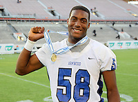 Armwood Hawks defensive lineman Byron Cowart #58 poses for a photo after the Florida High School Athletic Association 6A Championship Game at Florida's Citrus Bowl on December 17, 2011 in Orlando, Florida.  Armwood defeated Miami Central 40-31.  (Mike Janes/Four Seam Images)