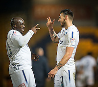 Adebayo Akinfenwa & Max Muller of Wycombe Wanderers celebrate the teams win during the The Checkatrade Trophy  Quarter Final match between Mansfield Town and Wycombe Wanderers at the One Call Stadium, Mansfield, England on 24 January 2017. Photo by Andy Rowland.