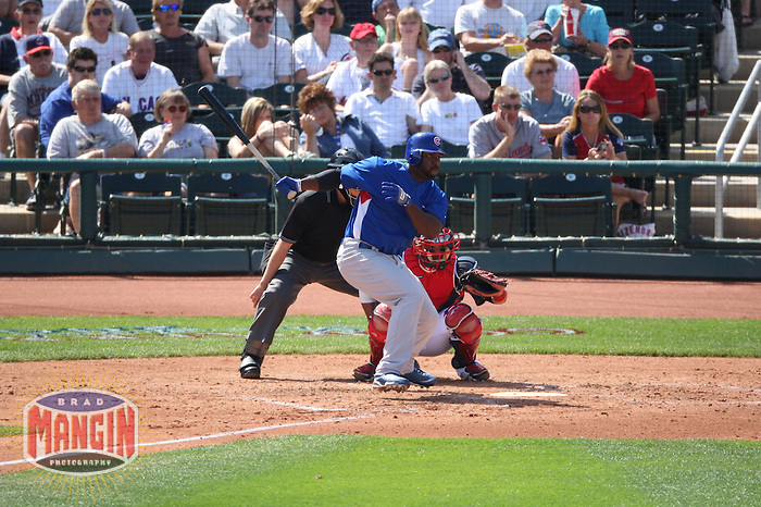 GOODYEAR, AZ - MARCH 4:  Milton Bradley of the Chicago Cubs bats during their spring training game against the Cleveland Indians at Goodyear Ballpark in Goodyear, Arizona on March 4, 2009.  Photo by Brad Mangin
