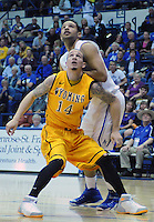 February 7, 2015 - Colorado Springs, Colorado, U.S. -  Wyoming guard, Josh Adams #14 and Air Force forward, DeLovell Earls #21, vie for a rebound during an NCAA basketball game between the University of Wyoming Cowboys and the Air Force Academy Falcons at Clune Arena, U.S. Air Force Academy, Colorado Springs, Colorado.  Air Force soars to a 73-50 win over Wyoming.