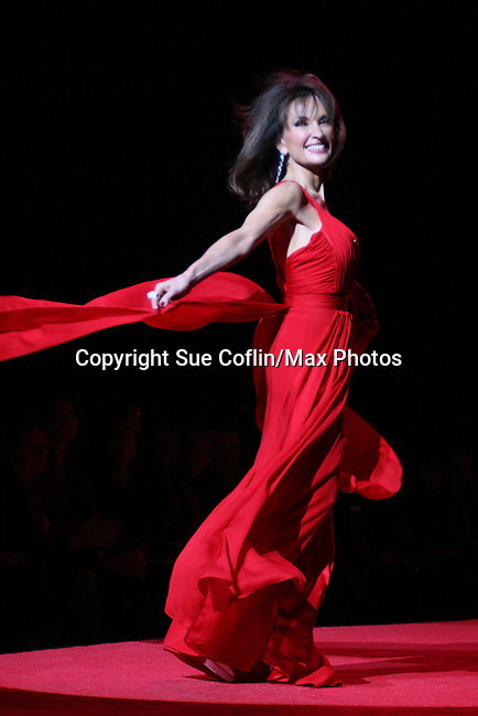 All My Children's Actress Susan Lucci wearing Gustavo Cadile walks the runway at The Heart Truth's Red Dress Collection 2009 Fashion Show which raises awareness that heart disease is the #1 killer of women was held during Mercedes -Benz Fashion Week New York Fall 09 on February 13, 2009 in Bryant Park, New York City, NY. This event unites with America's top designers to showcase a colleciton of one-of-a-kind Red Dresses. (Photo by Sue Coflin/Max Photos)