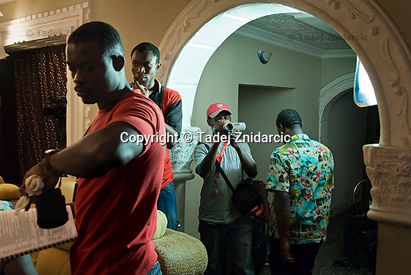 Crew members on the set of a Nollywood movie production. Thousands of Nigerians work as professionals in the Nollywood film industry, which has become the second largest employer in the country.