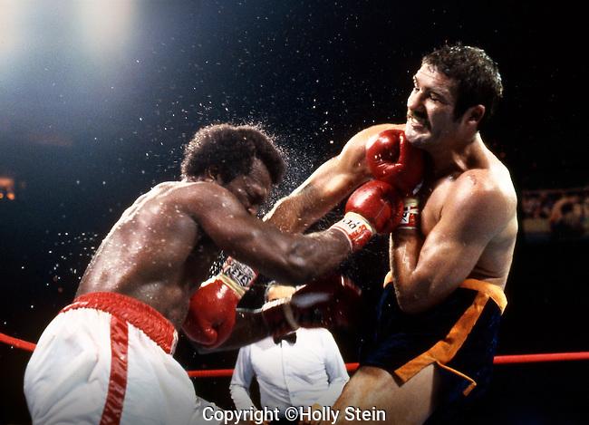 Michael Dokes v. Gerrie Coetzee.  Coetzee WKO10.  WBA Heavyweight title.