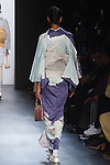 "Model walks runway in a ""Blue sea"" silk kimono from the Hiromi Asai Fall Winter 2016 ""Spirit of the Earth"" collection by Hiromi Asai & Kimono Artisan Kyoto, presented at NYFW: The Shows Fall 2016, during New York Fashion Week Fall 2016."