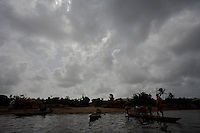 .... a young boy, works on a fishing boat in a lagoon in the Volta region, Ghana, on Saturday March 09 2007..