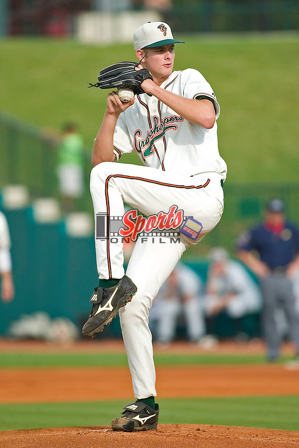 Greensboro's Chris Volstad winds up to deliver a pitch versus Hickory at First Horizon Park in Greensboro, NC, Thursday, June 8, 2006.  Hickory defeated Greensboro 5-4 in 8 innings.