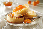 Apricot jam on buttered crumpets stock photos