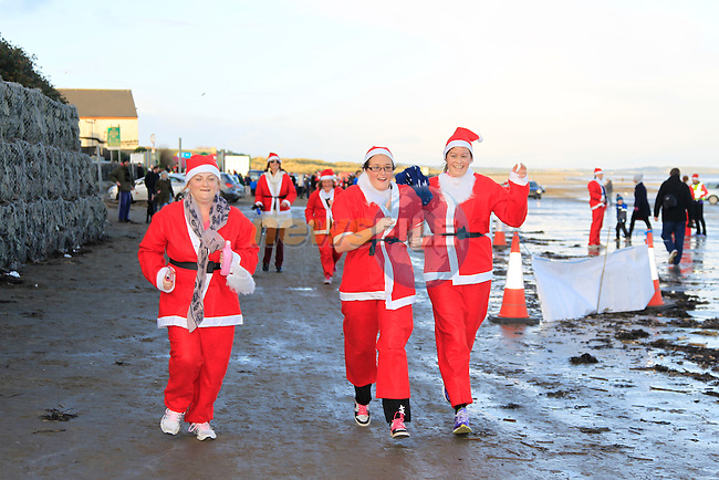 Lisa Mellor, Audrey O'Reilly and Hilary Dowdall from the Star Of the Sea (SOS) running club during The Great Santa 3k and Santa's little helpers run in Bettystown on Sunday 7th December 2014.<br /> Picture:  Thos Caffrey / www.newsfile.ie