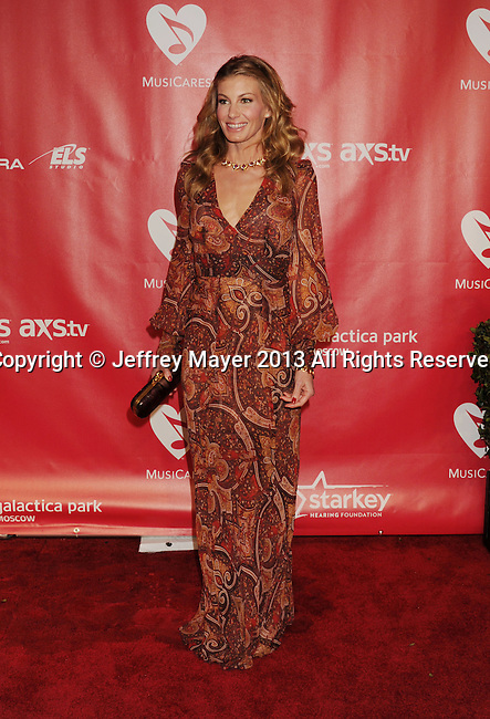 LOS ANGELES, CA - FEBRUARY 08: Faith Hill arrives at the 2013 MusiCares Person Of The Year Honoring Bruce Springsteen at Los Angeles Convention Center on February 8, 2013 in Los Angeles, California.