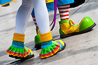 Clowns wear oversized multi colored shoes during the Clown Congress in San Salvador, El Salvador, 18 May 2011. The clown performance is considered a regular job in most of Latin American countries. Clowns may work individually or in groups, often performing advertisement like acts in large open-to-street shops or they take part in private shows, like children birthdays, family events etc. There are many clown conventions all over Latin America where clowns gather and exchange their experiences offering workshops of the comic acting or the art of make-up. For some of them, being clown is a serious lifetime profession.