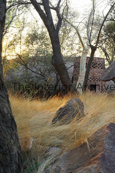 Rustic style round stone accommodation, part of the Singita Pamushana Lodge, Malilongwe Trust, Zimbabwe
