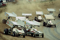 Steve Kinser and Sammy Swindell lead a group of cars during a 1979 World of Outlaws race at Eldora Speedway near Rossburg, Ohio.