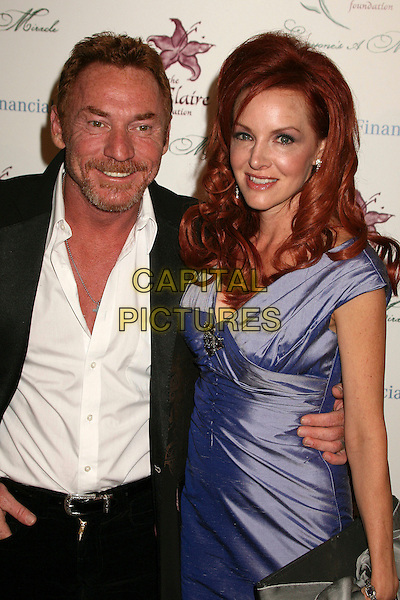DANNY BONADUCE & GRETCHEN BONADUCE.9th Annual Benefit for Lili Claire Foundation at the Beverly Hilton Hotel, Beverly Hills, California, USA..October 14th, 2006.Ref: ADM/BP.half length purple dress satin black wife husband married.www.capitalpictures.com.sales@capitalpictures.com.©Byron Purvis/AdMedia/Capital Pictures.