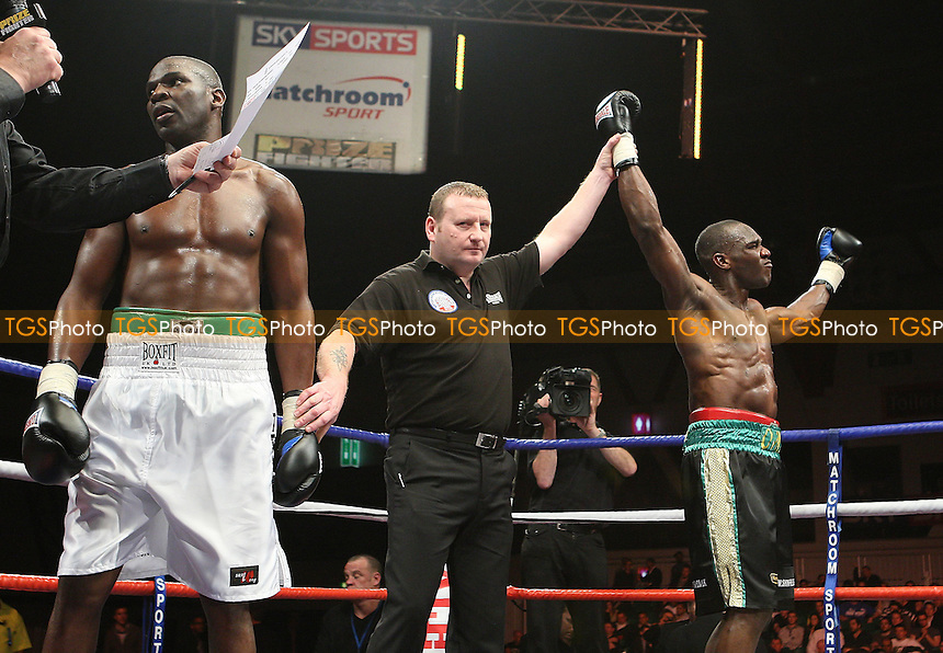 Ovill McKenzie (Canning Town, black shorts) defeats Terry Dunstan (Vauxhall, white shorts) - Round One of Prizefighter 'The Cruiserweights' Boxing contest at Earls Court, London - 19/05/09 - MANDATORY CREDIT: Gavin Ellis/TGSPHOTO - Self billing applies where appropriate - 0845 094 6026 - contact@tgsphoto.co.uk - NO UNPAID USE.