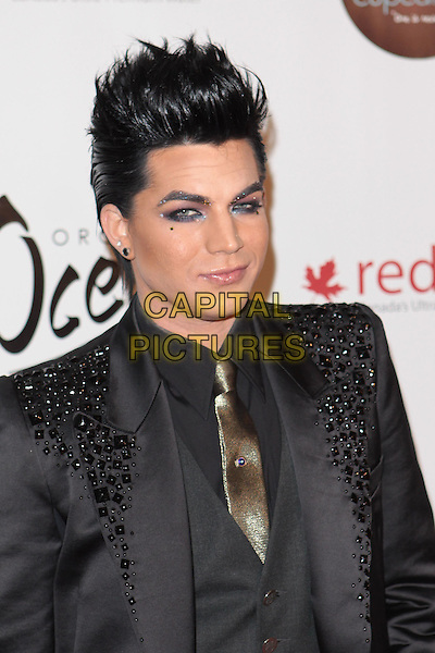 "ADAM LAMBERT.""Gridlock New Year's Eve Bash"" held at Paramount Studios, Hollywood, California, USA,  31st December 2009..portrait headshot black beaded shoulders gold tie shirt make-up guyliner eyeliner earring earrings glitter NYE new year's Eve.CAP/ADM/TC.©T. Conrad/AdMedia/Capital Pictures."