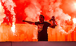 Stockholm 2014-09-28 Fotboll Superettan Hammarby IF - IK Sirius :  <br /> Hammarbysupporter med en megafon framf&ouml;r bengaliska eldar<br /> (Foto: Kenta J&ouml;nsson) Nyckelord:  Superettan Tele2 Arena Hammarby HIF Bajen Sirius IKS supporter fans publik supporters bengaler bengaliska eldar