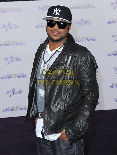 "THE DREAM (Terius Youngdell Nash).attending the Paramount Pictures' L.A. Premiere of ""Justin Bieber: Never Say Never"" held at The Nokia Theater Live in Los Angeles, California, USA,.February 8th 2011..half length cap hat sunglasses black leather jacket necklace .CAP/RKE/DVS.©DVS/RockinExposures/Capital Pictures."