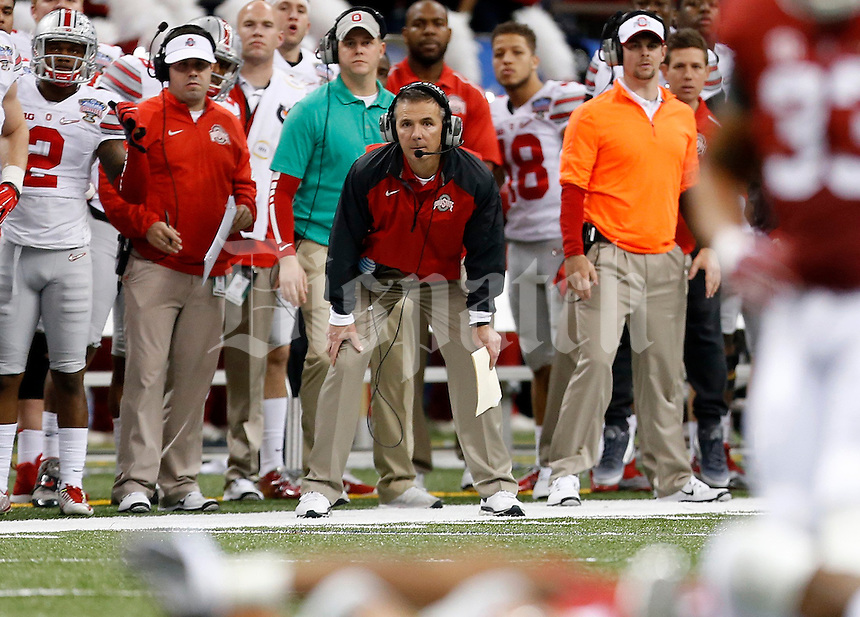Ohio State Buckeyes head coach Urban Meyer watches the action during the second quarter in the Allstate Sugar Bowl college football playoff semifinal at Mercedes-Benz Superdome in New Orleans on Thursday, January 1, 2015. (Columbus Dispatch photo by Jonathan Quilter)