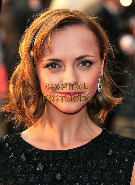 """CHRISTINA RICCI.""""Speed Racer"""" UK film premiere.Empire cinema, Leicester Square, London, England, UK.28th April 2008.portrait headshot crystal earrings green eyeshadow make-up.CAP/PL.©Phil Loftus/Capital Pictures"""