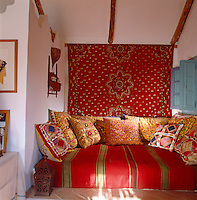The decorative treatment of the living room of the poolhouse is a celebration of Moroccan style