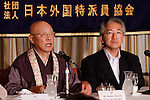 June 29th, 2011, Tokyo, Japan - Chief priest Shunwa Yamada, left, of Chusonji Buddhist temple and Gov. Takuya Tasso of Iwate Prefecture attend a news conference at the foreign press club in Tokyo on Wednesday, June 29, 2011, to celebrate the June 26 recognition of the centuries-old temple and landscape in the ancient town of Hiraizumi in the northeastern Japanese prefecture as UNESCOs World Heritage cultural site. Yamada presented his opinions on the impact the designation may have on tourism while Gov. Tasso laid out a plan to reconstruct the areas devastated by the March 11 earthquake and ensuing tsunami. (Photo by AFLO) [3609] -mis-