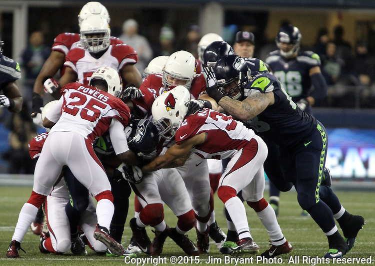 Seattle Seahawks Running back Marshawn Lynch rushes against Arizona Cardinals defenders at CenturyLink Field in Seattle, Washington on November 15, 2015. The Cardinals beat the Seahawks 39-32.   ©2015. Jim Bryant photo. All Rights Reserved.