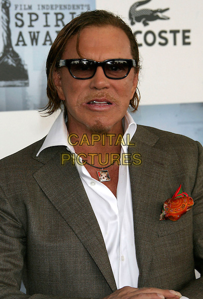 MICKEY ROURKE.2009 Film Independent Spirit Awards held at the Santa Monica Pier, Santa Monica, California, USA..February 21st, 2009.half length suit jacket white shirt grey gray orange goatee facial hair sunglasses shades funny face.CAP/ADM/MJ.©Michael Jade/AdMedia/Capital Pictures.