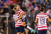 Tobin Heath (17) of the United States (USA) celebrates scoring with Abby Wambach (14). The United States (USA) and Germany (GER) played to a 2-2 tie during an international friendly at Rentschler Field in East Hartford, CT, on October 23, 2012.